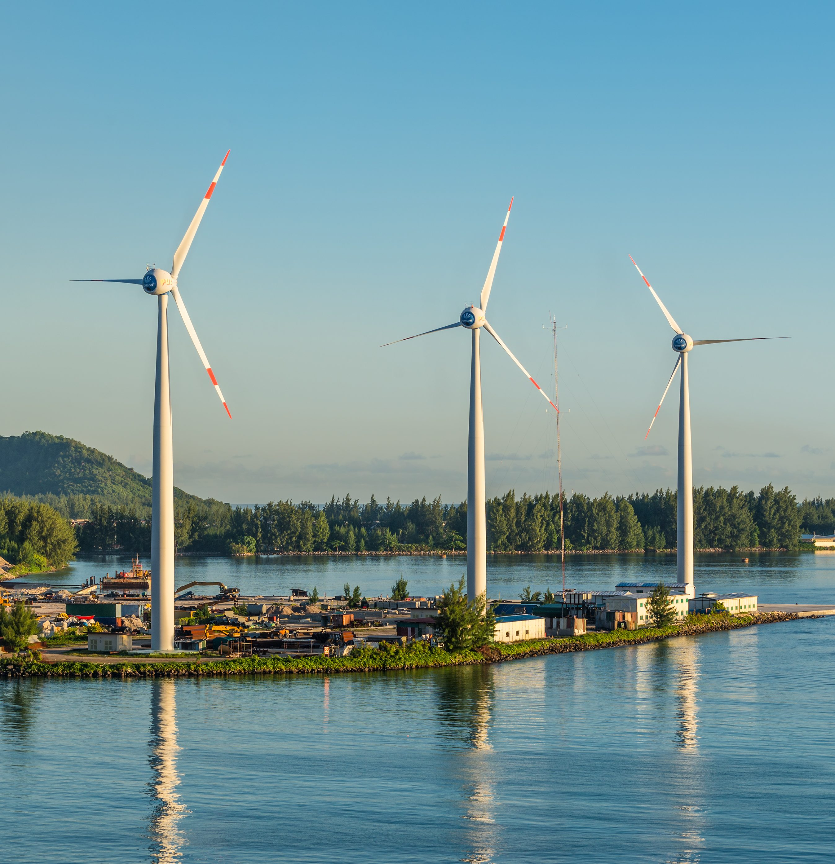 Victoria, Mahe island, Seychelles - December 15, 2015: Wind turbines producing clean electricity at dawn in Victoria, Mahe Island, Seychelles.